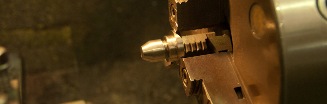 Precision machining of a small component on a lathe at GSI. Industrial Engineering.