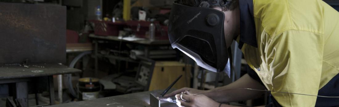 GSI staff fabricating a small bracket. Industrial Engineering.