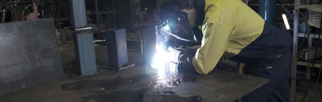 MIG welding new components in GSI's workshop. Industrial Engineering.